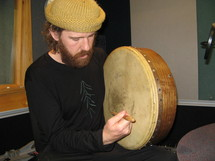 Chris OConnor playing a bodhran by Nick Atkinson IMG