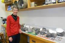 Dr Gillian Turner with the hangi stones