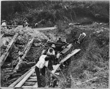 Mud Model T August Crossing on a makeshift bridge in the heart of the King country Courtesy National Library small