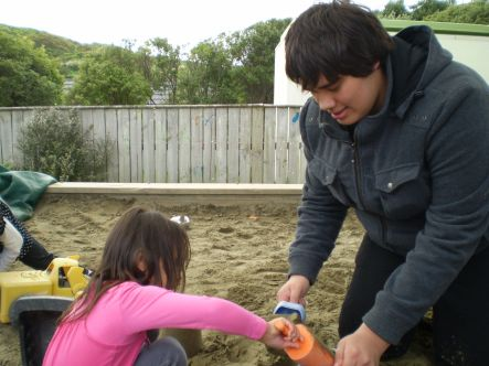 YMen T K Getting serious in the sandpit small