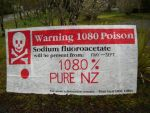 A protest message painted on a 1080 warning sign