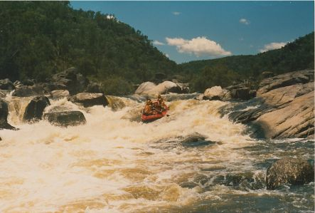 Rob Black Rafting Guide entering rapid