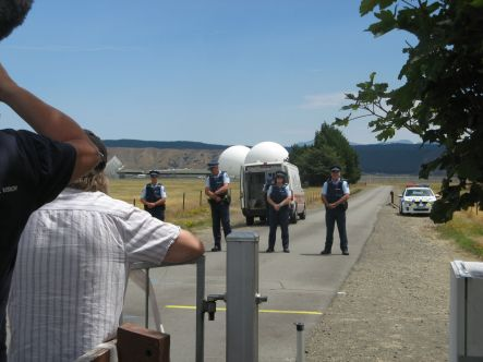 Waihopai Police confront protestors who later jumped the gate and entered Waihopai base perimeter small